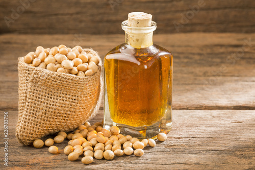 Foto Murales Oil and soybeans - Glycine max. Wooden background