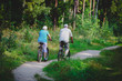 active senior couple riding bikes in nature