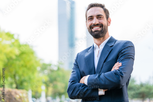 Portrait of successful businessman with arms crossed © Kzenon