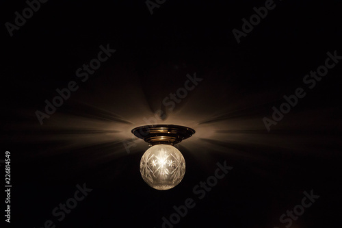 Foto Murales Light bulb lamp on blackboard background with copy space