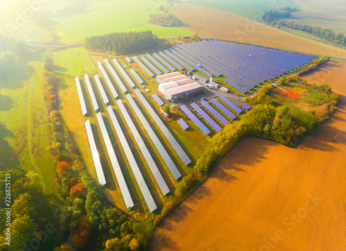 Leinwanddruck Bild Aerial view to solar power plant. Industry and renewable resources theme.