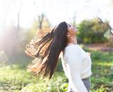 Beautiful hair model with waving glow hair