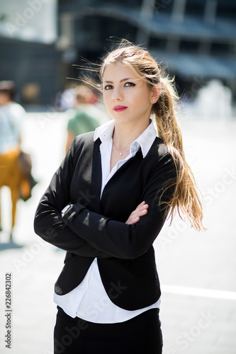 Confident young female manager outdoor in a modern urban setting © Minerva Studio