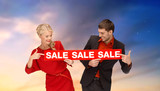 shopping and promotion concept - smiling couple with red sale sign over sky background - 226843721