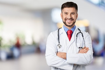 Handsome doctor portrait  on background