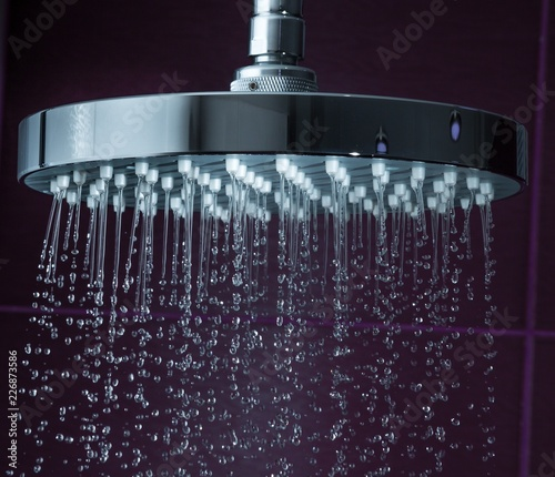 Leinwanddruck Bild Shower Head with Droplet clean Water, close-up view
