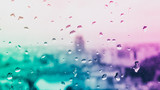Raindrops on the  glass, behind the glass blurred panorama of the old bright colored city, Neon Inspiration surreal abstract background wallpaper