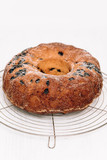 Traditional German or Austrian Gugelhupf or Kouglof from Alsace, France, a round bundt cake with raisins made of brioche yeast sponge or sweet bread dough and dusted with sugar - 226876136