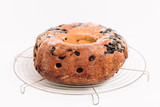 Traditional German or Austrian Gugelhupf or Kouglof from Alsace, France, a round bundt cake with raisins made of brioche yeast sponge or sweet bread dough and dusted with sugar - 226876197