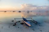 Boats on a tropical beach at sunrise - 226886531