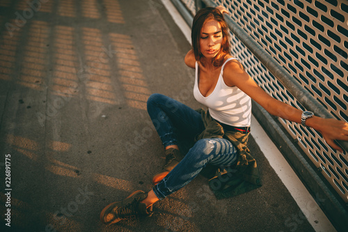 Young  woman posing on the street