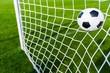 Leinwanddruck Bild - A Soccer Ball in a Net