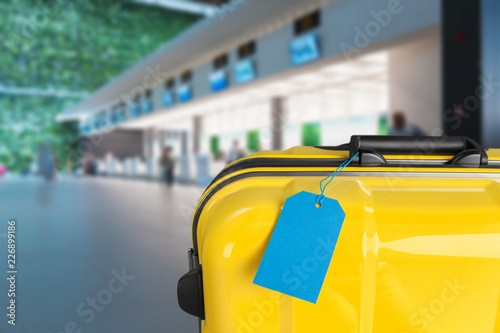 Yellow travel case with blue tage. Travel
