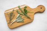 Fresh Herbs on a Cutting Board - 226910364