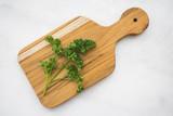 Parsley Sprigs on a Cutting Board - 226910372