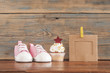 Delicious birthday �upcakes for a baby shower on wooden background