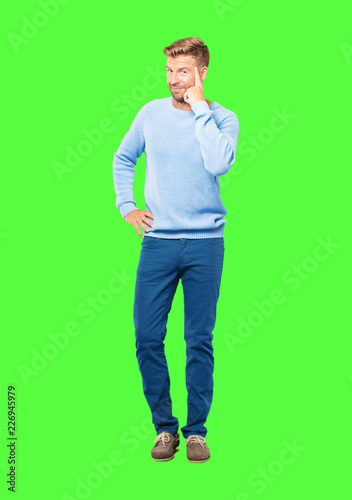 Leinwanddruck Bild young blonde man looking happy and surprised, smiling and thinking of an amazing new idea or solution, excited with epiphany and sudden inspiration.