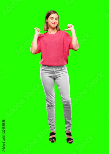"""Leinwanddruck Bild young woman full body. with a proud, happy and confident expression; smiling and sure of success, pointing to one's self with both hands, giving an """"achiever"""" look."""