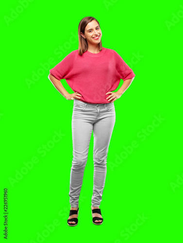 """Leinwanddruck Bild young woman full body. smiling proudly and confidently with arms hands on hips in akimbo pose, happy and sure of success, giving an """"achiever"""" look."""