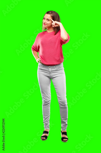 Leinwanddruck Bild young woman full body. looking happy and surprised, smiling and thinking of an amazing new idea or solution, excited with epiphany and sudden inspiration.