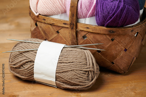 Leinwandbild Motiv colorful wool threads for knitting on wooden background