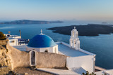 Iconic church with blue dome in Oia, Santorini island, Greece.