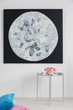 Leinwandbild Motiv Moon poster on white wall above silver table with pink phone in simple flat interior. Real photo
