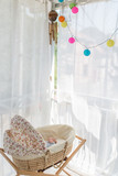 Baby crib moses basket next to window - 227002103