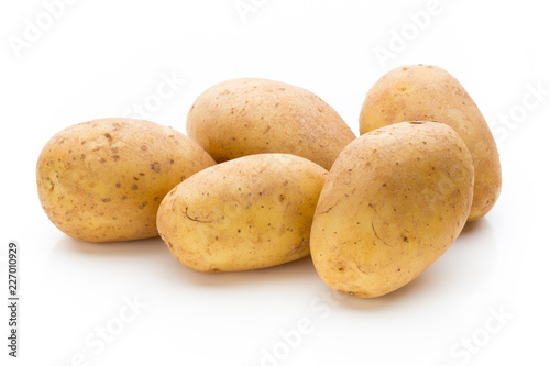 New potato isolated on the white background. © gitusik