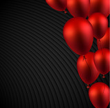 Black textured background with red shiny balloons. Holiday decoration.