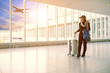 Leinwanddruck Bild - single woman and traveling luggage standing in airport terminal building