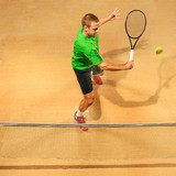I am saving this ball now. Player lunge, game of defense. The one caucasian fit man playing tennis at the earthen court . Player jumping in full length with racquet and ball. Emotions on face. Upper - 227031333