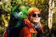 Quadro Female tourist hiking in autumn fantastic forest landscape
