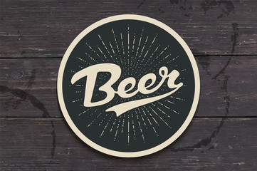 Coaster for beer with hand drawn lettering Beer. Monochrome vintage drawing for bar, pub and beer themes. Black circle for placing a beer mug or a bottle over it with lettering. Vector Illustration