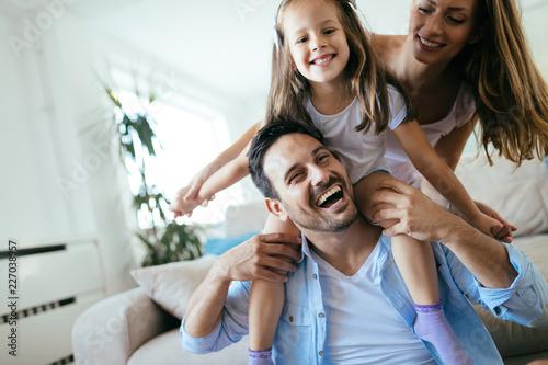 Foto Murales Happy family having fun time at home