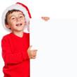 Kind Weihnachtsmann Nikolaus Weihnachten lachen Schild Textfreiraum Copyspace - 227057311