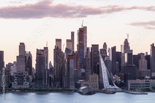 New York City midtown Manhattan sunset skyline panorama view from Boulevard East Old Glory Park over Hudson River.
