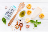 The ingredients for homemade pesto pasta on white wooden background. - 227066592