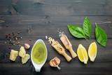 The ingredients for green pesto sauce on dark wooden background. - 227066723