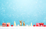 Reindeer and Christmas gifts in snowy day - 227073339