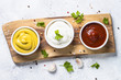 Leinwandbild Motiv Sauce set  - mayonnaise, mustard, ketchup on white.
