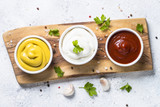 Sauce set  - mayonnaise, mustard, ketchup on white.