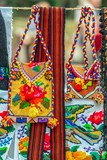 Background with traditional Romanian bags, belts and material embroidered - 227090170