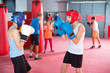 Leinwandbild Motiv Two young boxer wearing gloves and helmet sparring