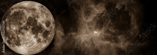 The moon and fantastic galacy clouds and stars background in sepia tone. Elements of this image furnished by NASA