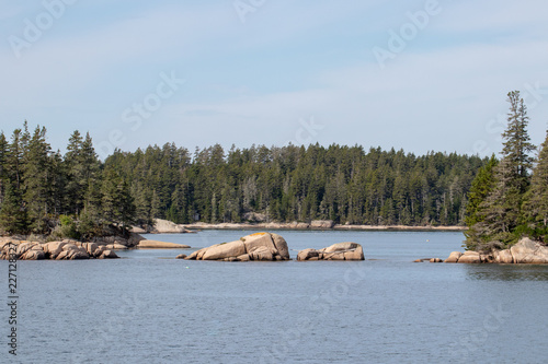 peaceful view of island with rocky coastline in Maine