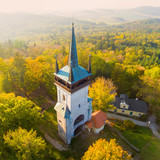 Aerial view to The Bolfanek viewtower with the St. Wolfgang´s cemetery chapel. Near a  marvelous village Chudenice from 12th century. Czech landmarks from above. Autumn in Central Europe. - 227130974