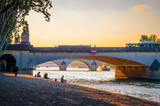 Sunset view on bridge and buildings on the Seine river in Paris, France