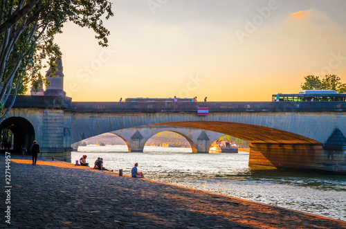Sunset view on bridge and buildings on the Seine river in Paris, France - 227144957
