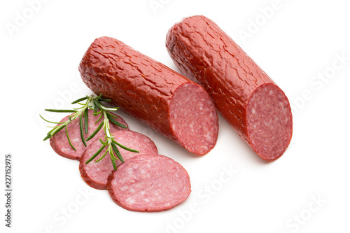 Leinwanddruck Bild Salami smoked sausage, basil leaves on white background cutout.